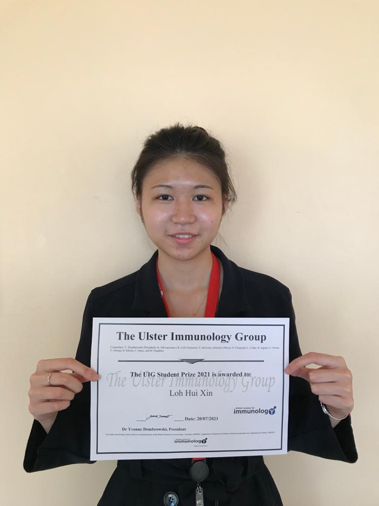 Woman holding a prize certificate
