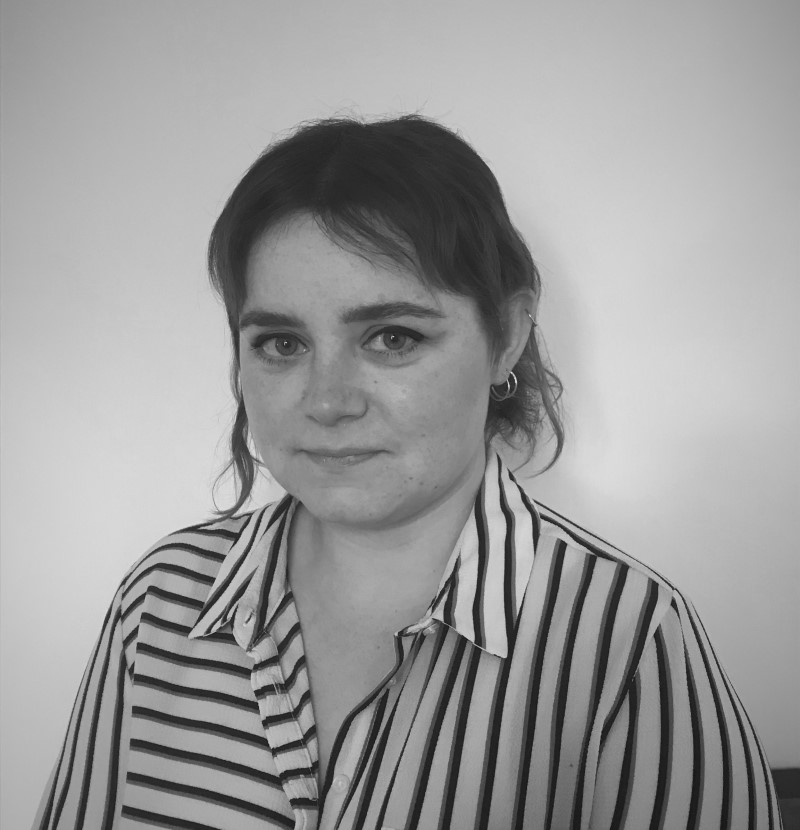 Headshot of woman in a striped shirt