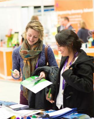 Delegates at exhibition stand